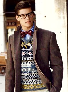 "A ""sweet"" vest with so much pizzaz requires that polka dotted bow tie to pull it off!... Well maybe it also requires a  handsome dude... the glasses, the striped shirt,  AND the neutral jacket...okaY?"