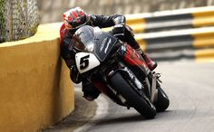 No cutting of this apex...   Stephen Davidson captured this astonishing shot of Steve Plater at the 2003 Macau Grand Prix  http://www.motourage.net/2011/11/qualifying-results-for-tomorows-macau-motorcycle-grand-prix/
