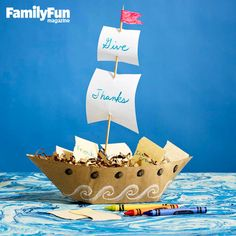 Boatload of Gratitude: This jaunty centerpiece sets sail with notes of thanks.