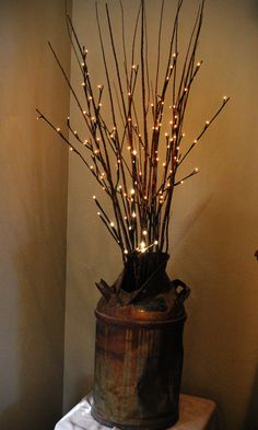 Lighted willow branches in my own antique milk can.