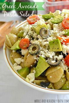 Greek Avocado Pasta Salad. -- Bring this amazing pasta salad to any cook-out and watch it disappear! | wholeandheavenlyoven.com