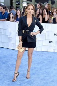 """Here's a challenge: Give Jennifer Lopez a sack and see if she can make it into a hot outfit. Chances are, she would. At the MTV Movie Awards, the """"Boy Next Door"""" actress took all things business out of her Versace blazer and made it suitable for a night out."""