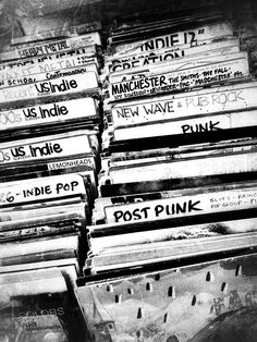 Those big plastic dividers in record stores, and the super-specific genre names the clerks write on them.