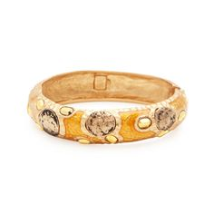 With a look that is striking - both in the colors and textures, this Adrienne offer an innovative design. It features hammered gold and brilliant orange enamel, offset by sparkling aurum crystals and vintage gold coins. A great statement bangle or stacked with your faves.   Find it on Splendor Designs