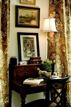 Love the draperies, framed prints and lamp, desk and chair.
