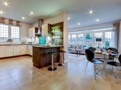 Superior design and style in this Mactaggart & Mickel open plan kitchen, dining are and sun room.