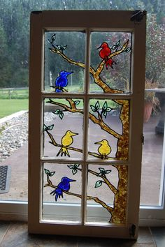 This piece is made from recycled products from Washington state. The window is from an old cottage and the colored glass is from sea glass and beer bottles. The window frame is weathered wood. Stained Glass Paint, Stained Glass Birds, Stained Glass Designs, Stained Glass Projects, Stained Glass Patterns, Stained Glass Windows, Mosaic Windows, Painting On Glass Windows, Glass Painting Designs