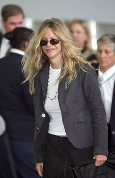Meg Ryan Blazer - Meg Ryan traveled through JFK airport in a grey blazer and her favorite pair of square shades.