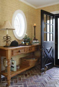 foyer floor - I like the brick and the herringbone pattern.