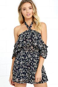 The Many Moons Ivory and Navy Blue Floral Print Romper will be a favorite for seasons to come! Floral print decorates soft woven rayon across a long sleeve bodice, drawstring waist, and flirty shorts. Hidden hook-and-eye closures fasten at back above a keyhole, and again at the V neckline for a custom fit! As Seen On Bree of @breekleintop, Ashley of the Blonde Collective blog and Paige of @paigesecosky!