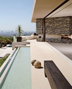 A rectilinear reflecting pool marks the front entrance to fashion designer Randolph Duke's hillside Los Angeles residence. Architects Austin Kelly and Monika Haefelfinger expanded and transformed the original house, adding a second level and opening the house to the site's 270-degree views of the city. (Fashion Designer RANDOLPH DUKE Makes a Statement in the Hills)