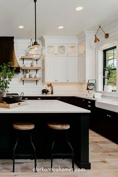 Black and white tuxedo cabinets are customized to this spacious Modern Farmhouse kitchen. Black and white tuxedo cabinets are customized to this spacious Modern Farmhouse kitchen. Modern Farmhouse Kitchens, Black Kitchens, Home Kitchens, Kitchen Cabinets Black And White, Kitchen Modern, Kitchen White, Black Kitchen Island, Black Kitchen Countertops, Two Tone Kitchen Cabinets