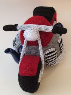 The Motorcycle tea cosy from the TeaCosyFolk range of tea cosies has bags of character. You can buy the Motorcycle tea cosy as a finished hand crafted tea cosy , or as a Motorcycle tea cosy knitting pattern to make your own tea cosy with character