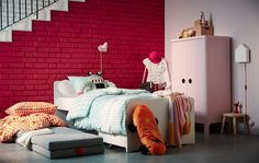 Kid's furniture like the IKEA SLÄKT bed, storage unit, and mattresses are a compact solution for a small space children's bedroom. Fold out the mattresses from under the bed, and you have a sleepover bed.