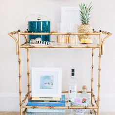 No more getting up to refill your guest's drinks with this bar cart! The Bamboo Trolley Bar Cart has got it all--two shelves for extra storage, simple stylish design, and WHEELS for a little added coc