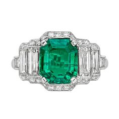 2.93 Carat Colombian Emerald & Diamond Ring | From a unique collection of vintage three-stone rings at http://www.1stdibs.com/jewelry/rings/three-stone-rings/