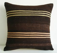 usually go for more color, but i love this combo of pillows........