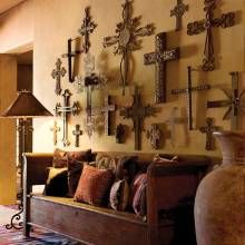 Rustic cross display walls need a good mix of small and large crosses made of wood or metal in varying sizes so the weight of the objects feels balanced Love the crossed