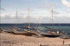 Outrigger Canoes on the beach at Ujelang Island, Marshall Islands. | by David A's Photos