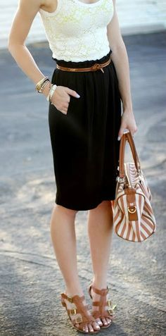 Sleeveless ivory lace top, black belted pencil skirt, strappy tan sandals, and tan and cream striped bag.