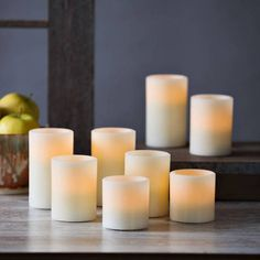 Lights.com | Lit Decor | Flameless Candles | Pillar Candles | Flat Top Flameless Cream Wax Pillar Variety Set with Remote, Set of 8