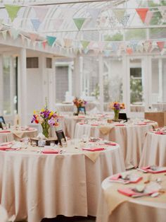 Lovely Bunting made by the bride! Colorful spring wedding!  Venue   The Gardens of Bammel Lane Houston Wedding Photographer   Christa Elyce Photography ©ChristaElyce.com www.christaelyce.com