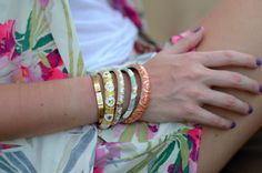bracelets and purple nail polish