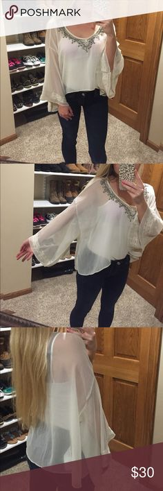 Abercrombie & Fitch Top Gorgeous sheer bell sleeve beaded Abercrombie & Fitch cream top. Size small but could easily fit a medium as well- has a high/low kind of feature but not too noticeable. Lace accents on bell sleeve along with beading on front and back Abercrombie & Fitch Tops Blouses