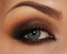 Brown and Orange smokey eye. I like this because brown eye shadow really brings out blue eyes, so, since I have blue eyes, I'm definitely trying this!