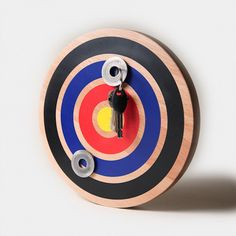 Designers from Bower have created the magnetic target which is used as a very original key holder Magnetic Key Holder, Key Organizer, Organizers, Pretty Cool, Art Furniture, Crafts To Do, Cool Gadgets, Key Rings, Gift Guide