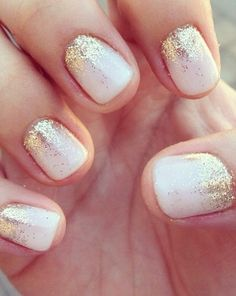 White nails with gold glitter.