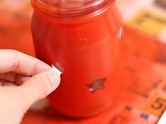 Spray paint over stickers on mason jars to create luminaries. Great idea for outside lighting.