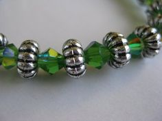 Green Crystals and Metal Alloy Stretch Bracelets by GoldCatJewelry, $4.00 - Made by my clever daughter-in-law!