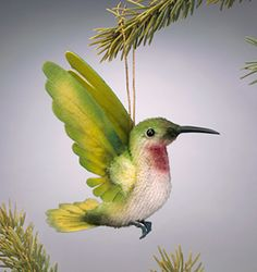 """RJW - Ruby  Authentic """"Archilochus Colubris"""" (Ruby throat) hummingbird native to North America. Description: 4"""" long; mohair plush; felt and organdy wings; glass eyes; bronze feet. Date of Release: 2004 Ltd. Ed. 500. First piece in the HUMMINGBIRD COLLECTION"""