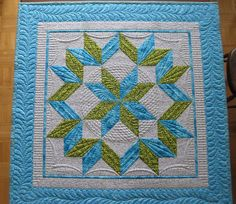 """I love the piano keys """"going behind"""" the ribbon border.  Great quilting by Donna James!"""