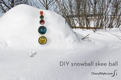 DIY skee ball game played with snowballs | at beach in summer cherylstyle.com