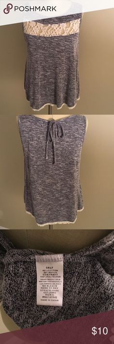Heather grey flowy lace top Pretty sleeveless top. Heather grey. Features a tie back and lace detail on front. Looks adorable with pink skinny jeans and heels. In great condition. Tops Tank Tops