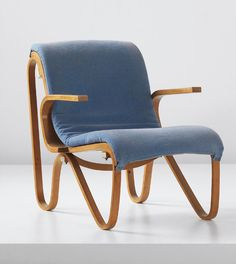 Gerrit Thomas Rietveld; #R54 Bent Beechwood, Plastic-Covered Springs and Brass Armchair for Metz & Co., 1942.
