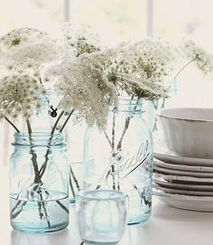 LOVE baby's breath, and the mason jars give it the rustic feel. hello, wedding flowers :)