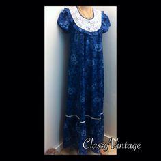 Vintage Hawaiian blue dress. Deep silky blue vintage dress. Made by Sears. Short sleeves - back zipper - lace bodice. Big ruffle on bottom. Tag size 12.  Bust 38 and length 67 inches. No flaws Sears Dresses