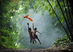 Indonesian children from rural areas playing a kite