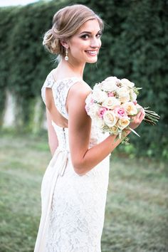 A fitted lace bridal gown with a sweetheart neckline and open, keyhole back.   Kennedy Blue Bridal Gown Kate
