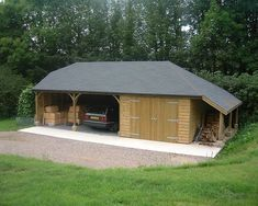 Two open carports, 1 enclosed garage. Bitumen Felt Slate roof with one half hip and one full hip ( with a logstore ) at 30 degree pitch