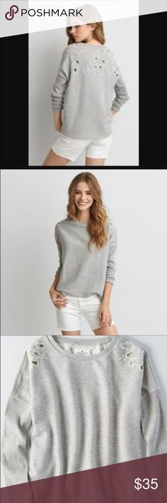 AE Cutout Sweatshirt NWT. Available in sizes S-L. Flowy bodice. Cutout detailing on shoulders and across back. American Eagle Outfitters Tops Sweatshirts & Hoodies
