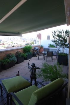 Retractable awning in nyc penthouse by Breslow Home Design www ...