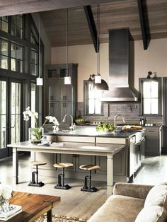 Contemporary Kitchen with Farmhouse Sink, Stone Source Basaltina Honed Basalt, Kitchencraft chelsea cabinetry, Pendant Light