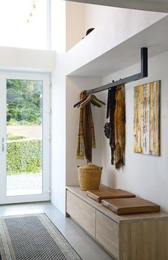 Efficient  practical entry -  suspended coat rack  built-in credenza/bench. Labor Junction / Home Improvement / House Projects / Entry Way / House Remodels / www.laborjunction.com