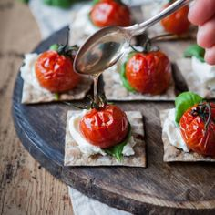 Making this tonight! Chèvre cream, with a leaf of Basil, an oven roasted tomato and then some spruce shoot syrup on a super thin cracker from Mjälloms Tunnbröd