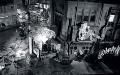 Black-and-white set photo of a street corner in Blade Runner (1982).