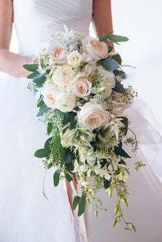 Classic cascading bouquet by Demco Florist Bermuda (Photo by Alexander Masters) More